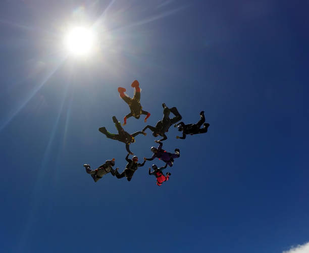 Skydiving group formation stock photo