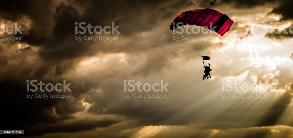 Skydiving in sunset stock photo