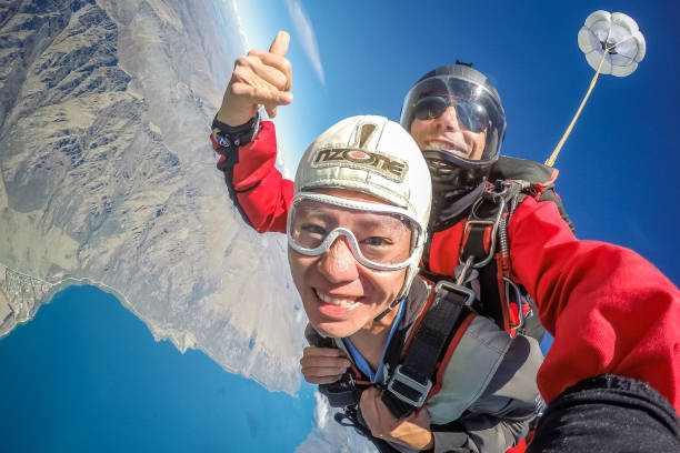 Skydiving on Queenstown in New Zealand. stock photo