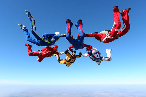 Skydiving photo. Building a group of paratroopers ring in free fall. parachuting stock pictures, royalty-free photos & images