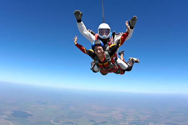 skydiving photo. tandem. - fallskärm bildbanksfoton och bilder