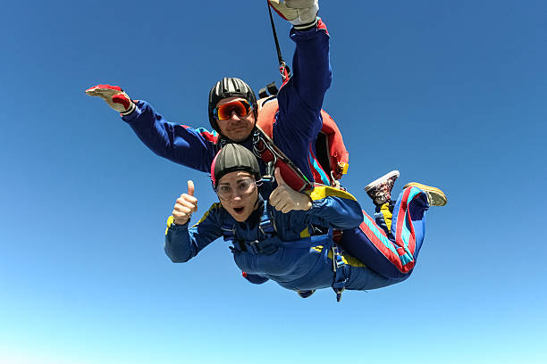 Skydiving photo. Tandem. Tandem jump. Flying in a free fall. parachuting stock pictures, royalty-free photos & images
