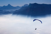 skydiving - skydiver in blue sky