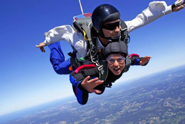 Skydiving tandem exhilaration stock photo