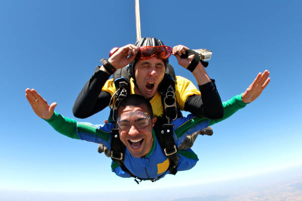 Skydiving tandem grimace stock photo