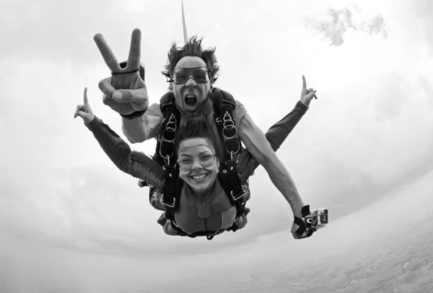 Skydiving tandem happiness black and white stock photo