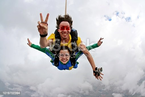 Skydiving tandem peace and love sign