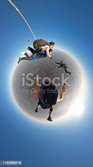 istock Skydiving tandem small planet 1132656418