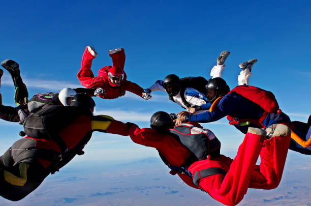 Skydiving teamwork formation stock photo