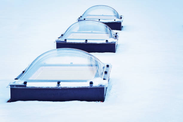 skylight glass domes on roof of building in snow helsinki - cupola stock pictures, royalty-free photos & images