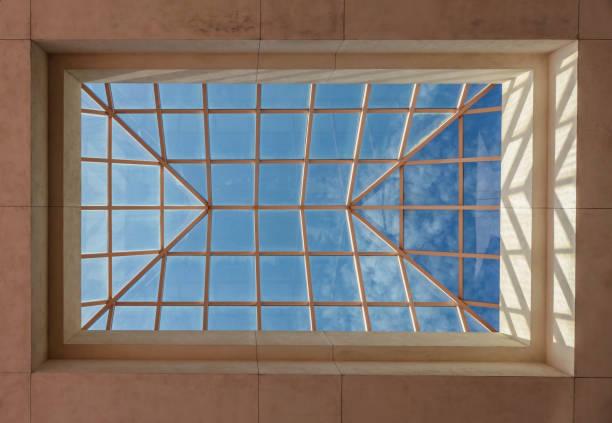 Skylight in large public building under blue sky