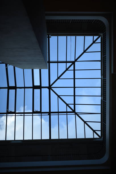 Skylight in the ceiling on a sunny day Skylight in the ceiling on a sunny day right angle stock pictures, royalty-free photos & images