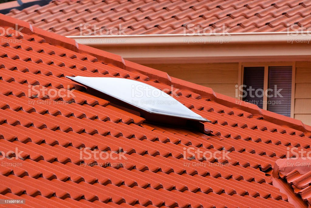 Skylight on roof from red terracota roof tiles royalty-free stock photo