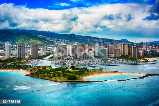 The beautiful coastline Honolulu Hawaii shot from an altitude of about 500 feet during a helicopter photo flight over the Pacific Ocean.