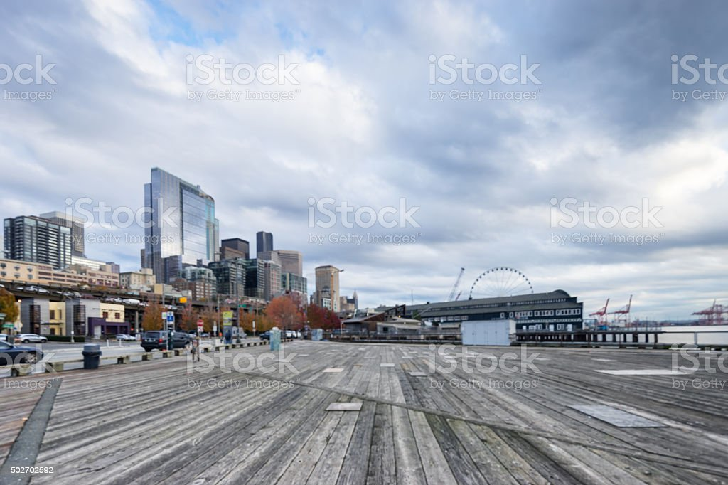 skyline and old wooden floor front of city buildings stock photo