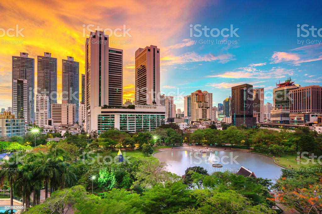 skyline and park in Bangkok Thailand with awesome sunset sky stock photo