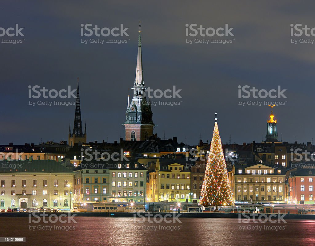 Skyline at night in Stockholm with lit up Christmas tree stock photo