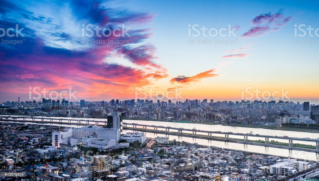 skyline bird eye aerial view with Mountain Fuji under dramatic sunset glow and beautiful cloudy sky in Tokyo, Japan stock photo