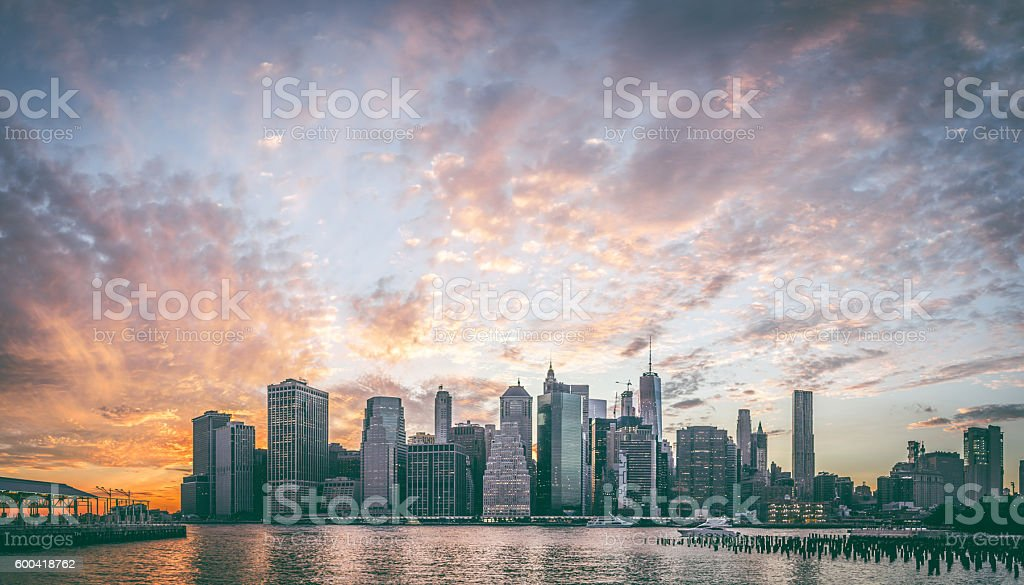Skyline New York City Manhattan and Brooklyn Bridge At Sunset stock photo