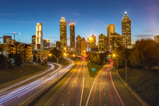 Skyline of Atlanta from Jackson Street Bridge at Dusk stock photo