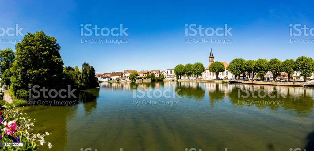 skyline of Audincourt at the river Doubs in France stock photo