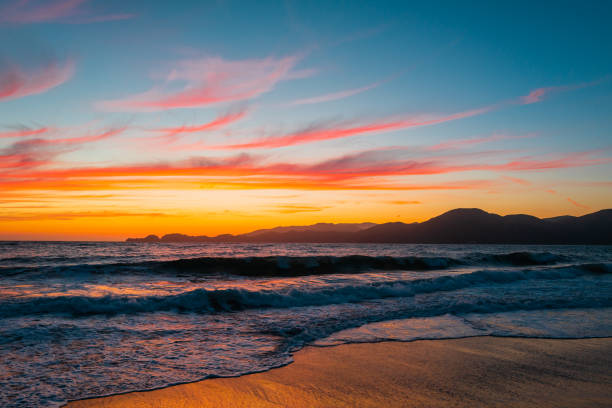 Skyline of Baker's Beach during a sunset in San Francisco, California, USA