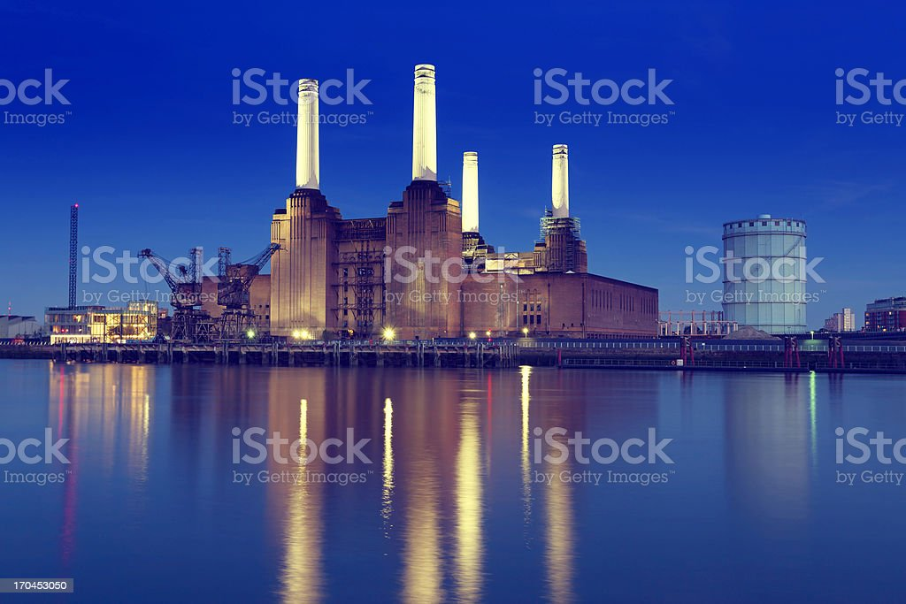 Skyline of Battersea Power Station with lake reflection stock photo