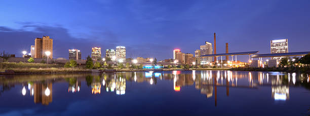 Skyline of Birmingham, Alabama reflected in a river stock photo