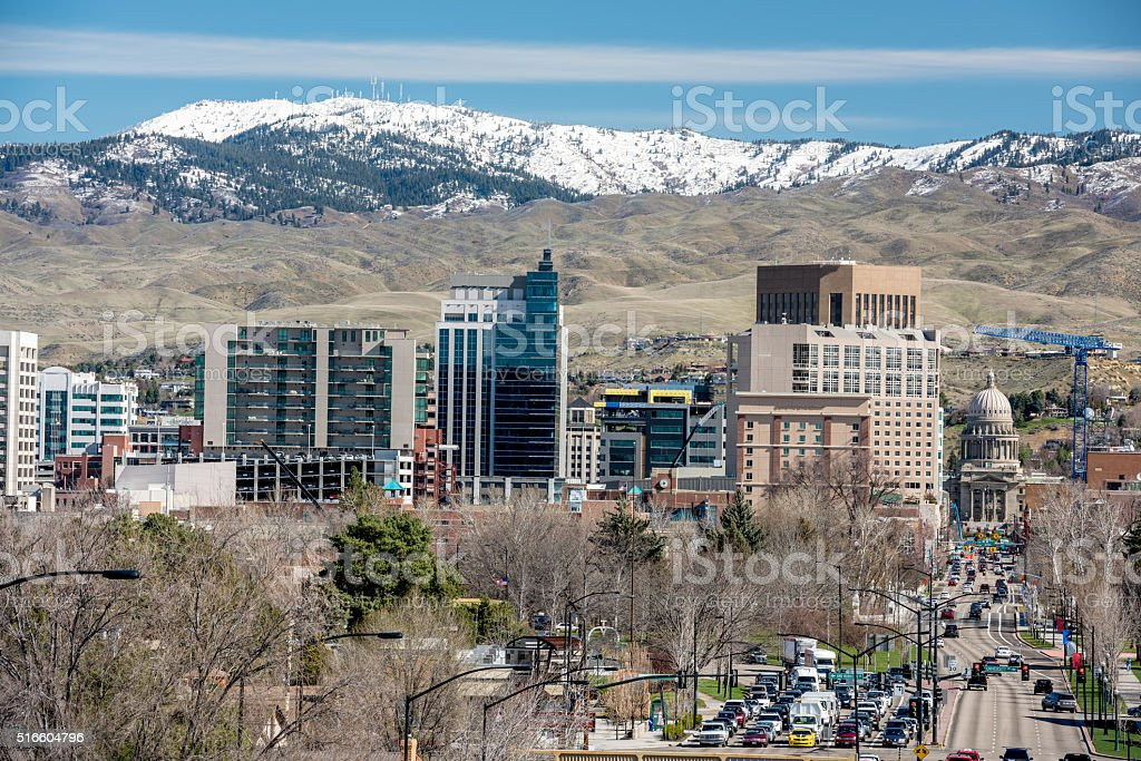 Skyline of Boise with mountains covered with snow stock photo