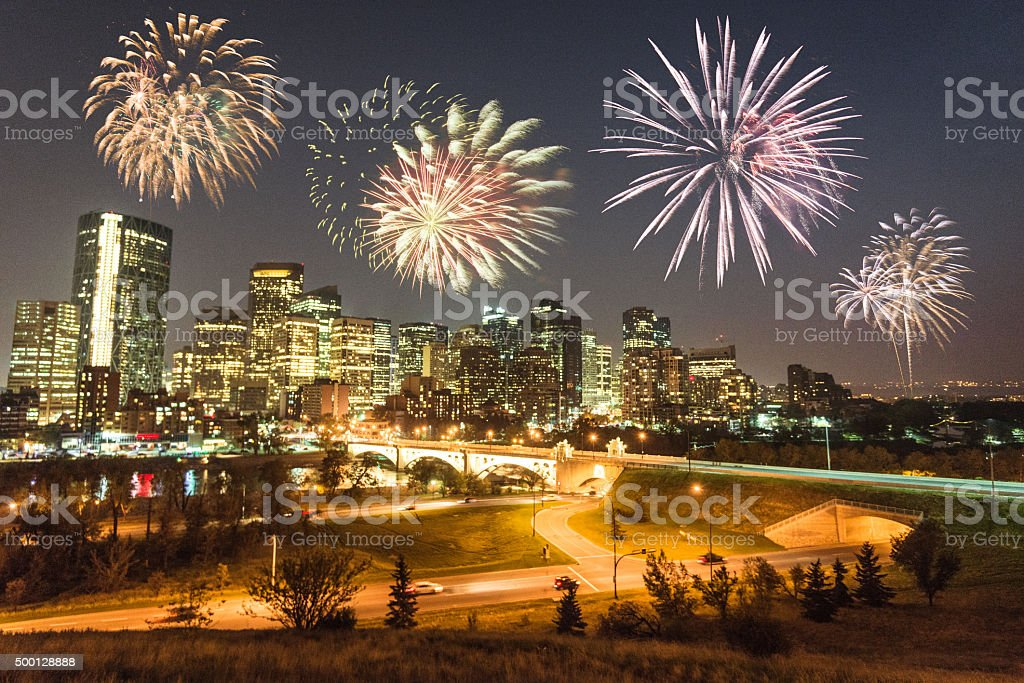 skyline of  calgary with fireworks for the new year stock photo