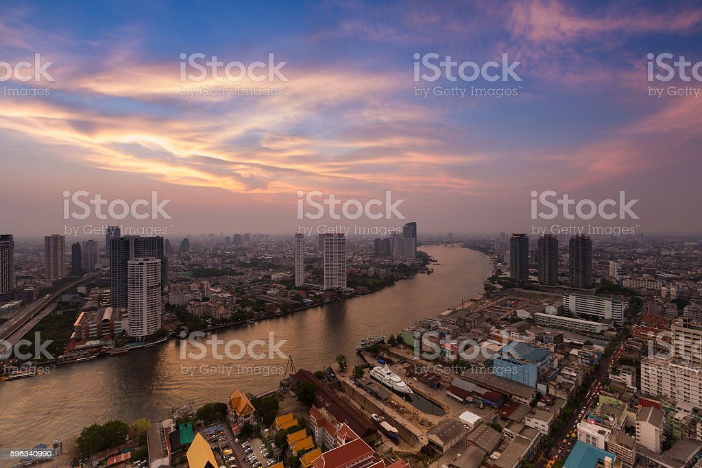 Skyline of Chao Phraya river curve after sunset royalty-free stock photo