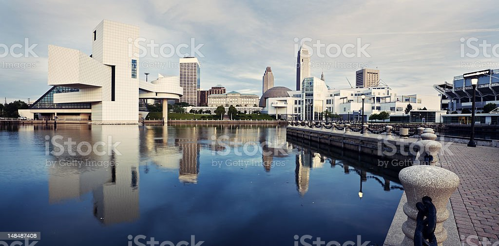 Skyline of Cleveland buildings reflected on water stock photo