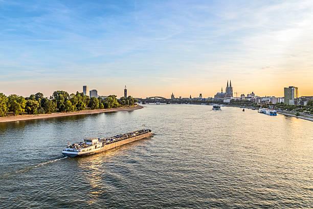 skyline of cologne with river rhine - rhein stock-fotos und bilder