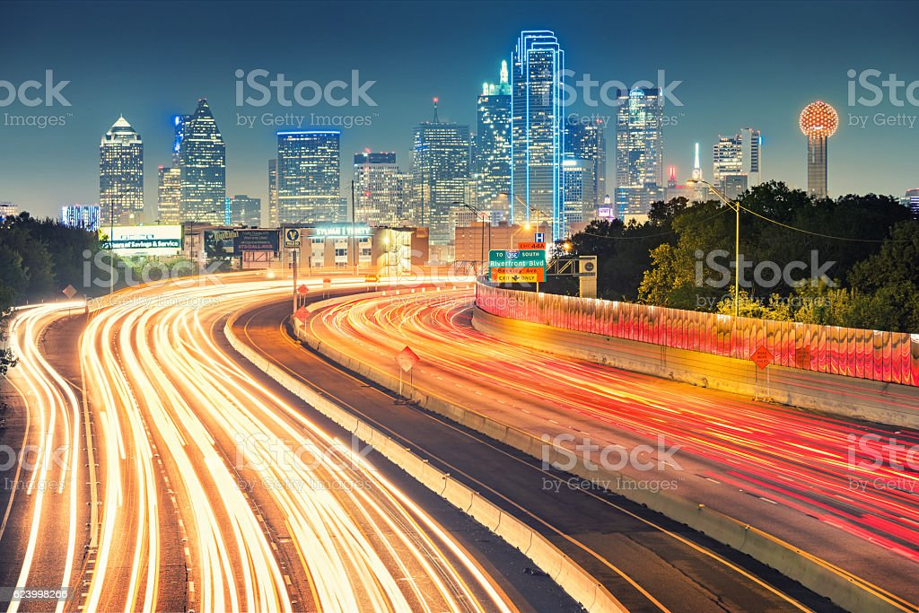 Skyline of Dallas Texas USA and Freeway at Night stock photo