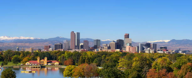 Skyline of Denver downtown with Rocky Mountains stock photo