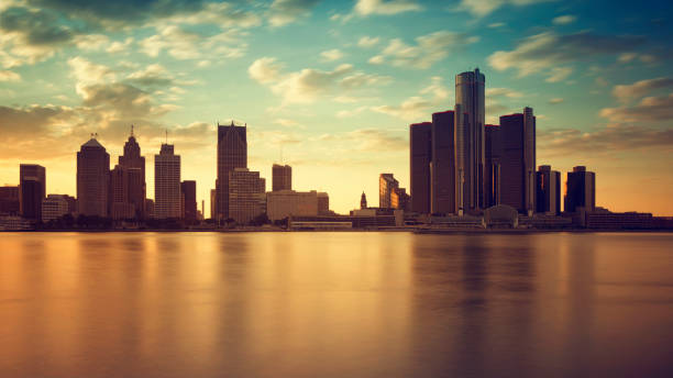 Skyline of Detroit City Beautiful skyline of Detroit city, photos taken from Canadian side, Windsor, Ontario. detroit michigan stock pictures, royalty-free photos & images