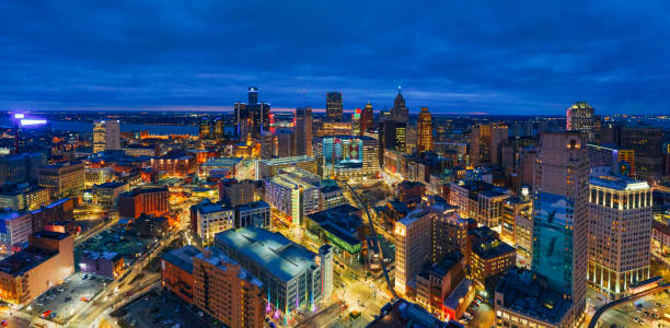 Skyline of Detroit Michigan at sunset aerial stock photo