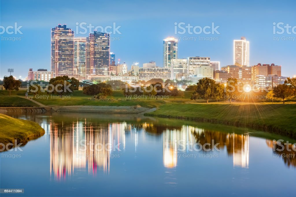 Skyline of downtown Fort Worth reflecting in West Fork Trinity River Texas USA stock photo