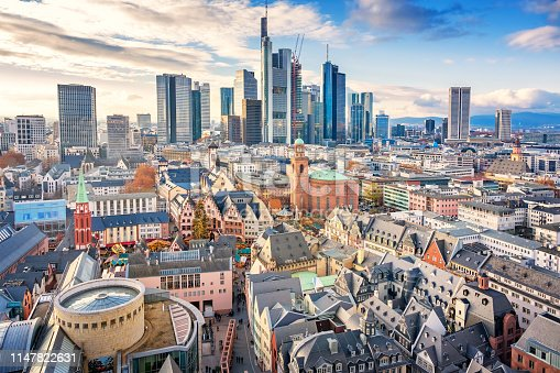 Stock photograph of the skyline of downtown Frankfurt am Main Germany with the old town in the foreground on a sunny day.