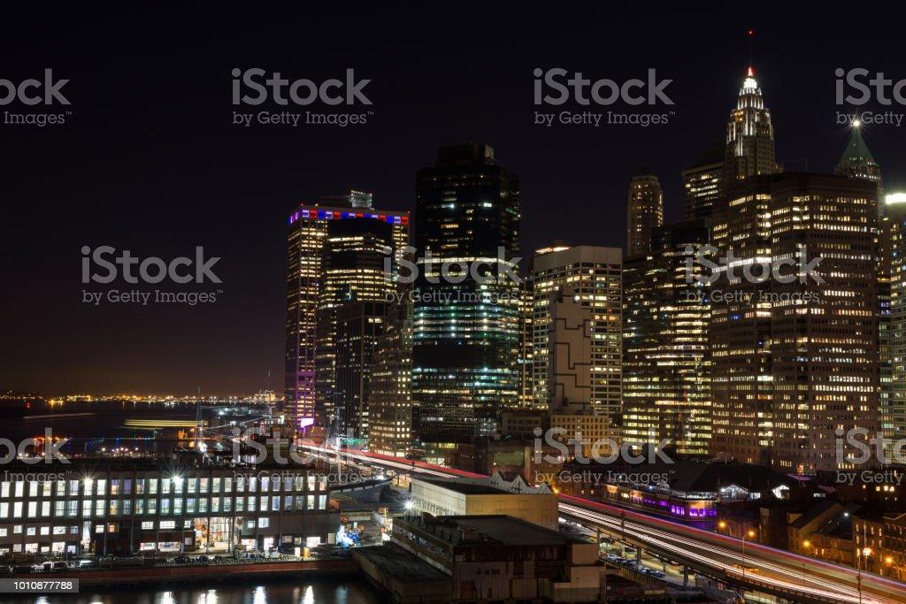 Skyline of downtown Manhattan by night stock photo