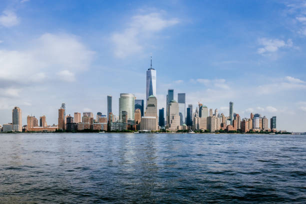 Skyline of Downtown Manhattan over Hudson River Skyline of Downtown Manhattan over Hudson River Viewed from New Jersey hudson river stock pictures, royalty-free photos & images