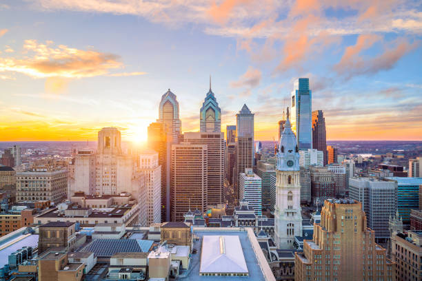 skyline of downtown philadelphia at sunset - philadelphia skyline stock photos and pictures