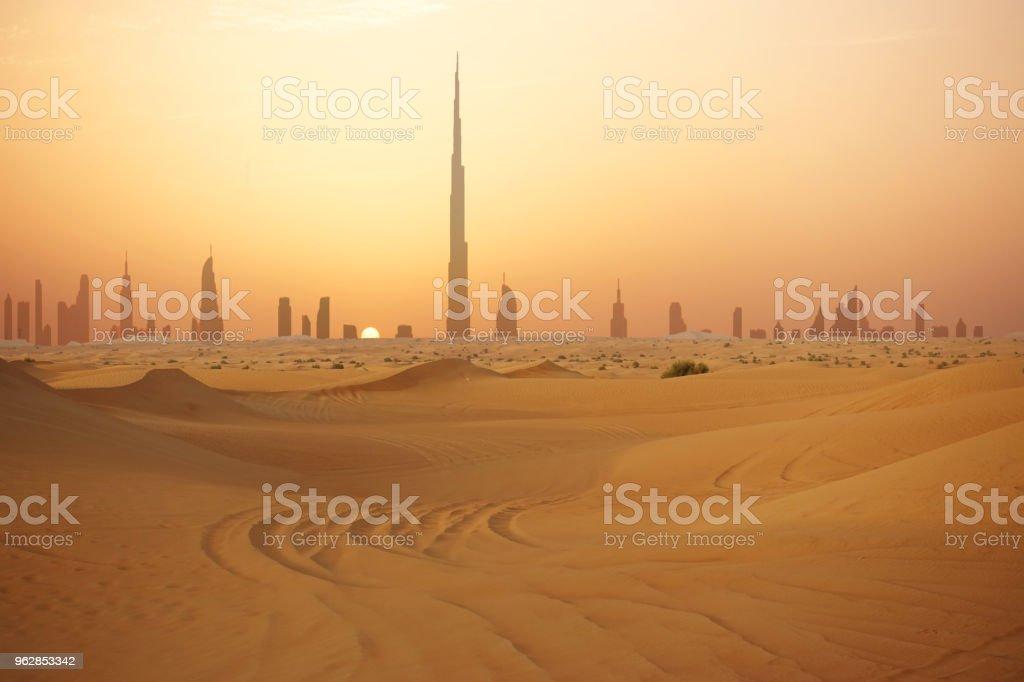 Skyline of Dubai at sunset or dusk, view from Arabian Desert stock photo