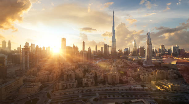 Skyline of Dubai Downtown at sunset with a dramatic sky stock photo
