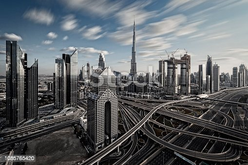 512697874 istock photo Skyline of Dubai, UAE. Futuristic modern architecture of a big city - long time exposure with a large highway intersection. 1085765420