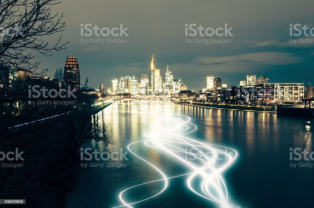 Skyline of Frankfurt am Main at night with light trails stock photo