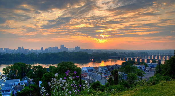 Skyline of Harrisburg Pennsylvania during sunrise  Harrisburg Pennsylvania skyline.  An HDR image from three exposures. pennsylvania stock pictures, royalty-free photos & images