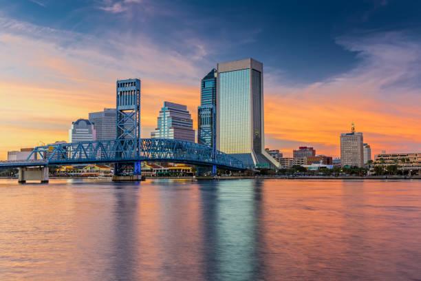 Skyline of Jacksonville, FL and Main Street Bridge at Sunset stock photo