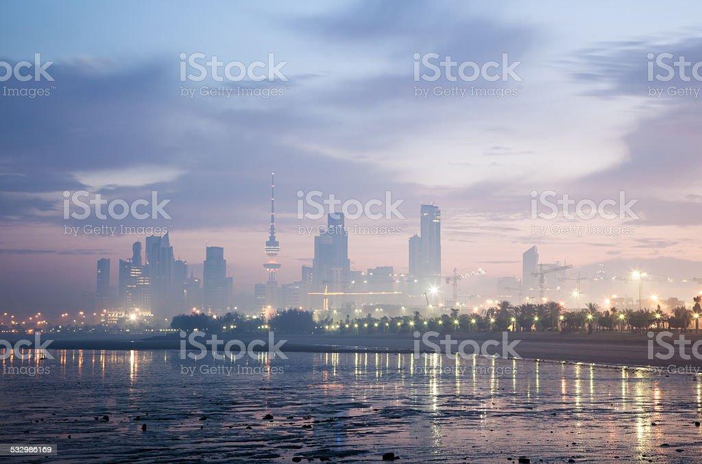 Skyline of Kuwait City at dawn stock photo