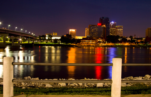 Skyline of Little Rock Arkansas with the Arkansas River in the foreground.